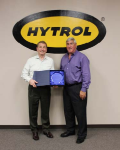 Don Laux presents Gregg Goodner with 50-year partnership award